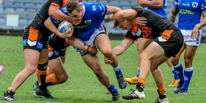 Newtown Jets front-rower Jaimin Jolliffe takes on the Wests Tigers defence at Campbelltown on Saturday. Photo: Gary Sutherland Photography.