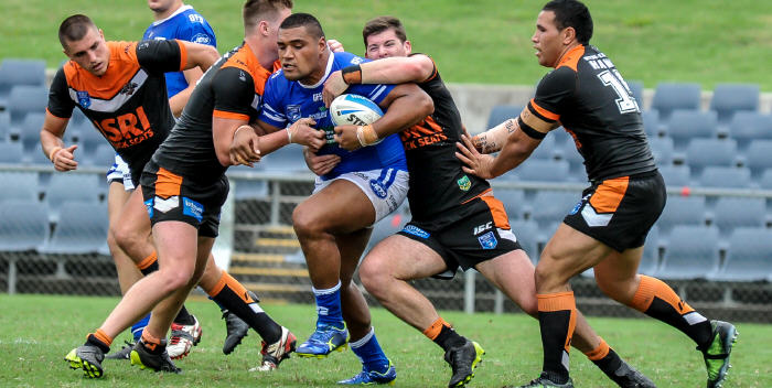 Newtown Jets front-rower Saulala Houma attempts to break through the Wests Tigers defence last Saturday at Campbelltown Stadium. Photo: Gary Sutherland Photography