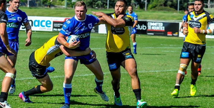 Newtown Jets second-rower Jack Williams is nabbed by the Mounties defence, with Daniel Mortimer (on the left) close by. Photo: Gary Sutherland Photography