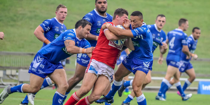Newtown Jets forwards Jason Schirnack (left) and Manaia Cherrington tackle an Illawarra opponent at WIN Stadium, Wollongong on Saturday. The Newtown Jets players in the background are (from left): Jack Williams, Saulala Houma, Jaimin Jolliffe, Matt Evans and Penani Manumalealii. Photo: Gary Sutherland Photography