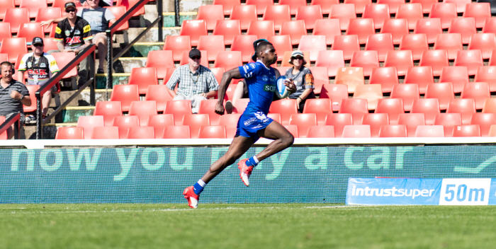 We have an inkling that Edrick Lee, formerly with the Canberra Raiders, is going to become a cult figure at Henson Park. He is pictured here racing away for the 95 metres try that put Newtown back into the contest against Penrith last Sunday. Photo: MAF Photography
