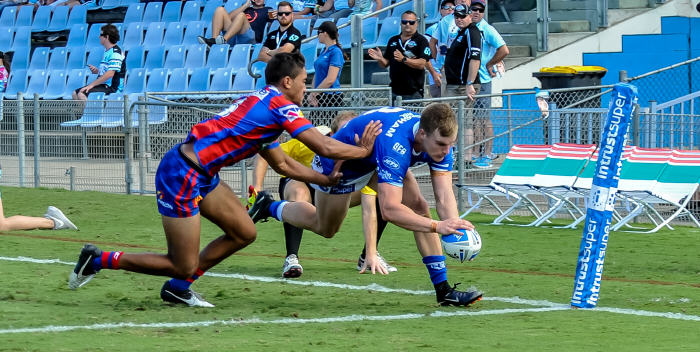 Jordan Drew scores for the Newtown Jets in the second half of last Saturday's game against the Newcastle Knights at Southern Cross Group Stadium. Photo: Gary Sutherland Photography
