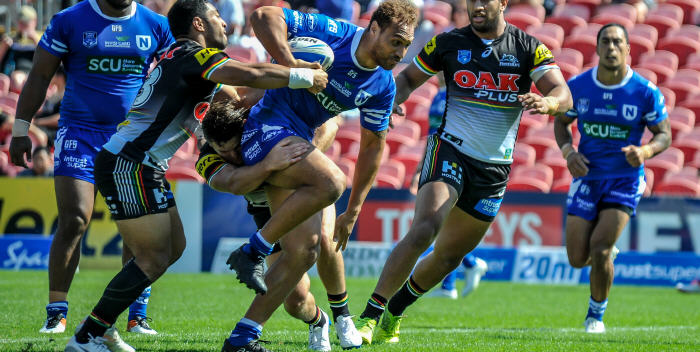 Newtown Jets front-rower and Samoan international Sam Tagataese takes on the Penrith defence on Sunday, with Tony Williams (left) and Kurt Kara also in the picture. Photo: Gary Sutherland Photography