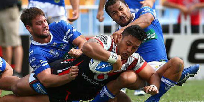 New Zealand Warriors front-rower Albert Vete scores against the Newtown Jets on Sunday, despite the close attention of Jayden Walker (left) and Penani Manumalealii (right). Photo: Photosport NZ