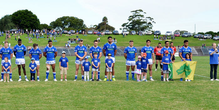 A heart-warming all-Australian image as the Newtown Jets of 2017 line up with children from St Michael's School, Stanmore prior to a pre-Anzac Day ceremony at Henson Park on Saturday, 22nd April 2017. Photo: Michael Magee Photography