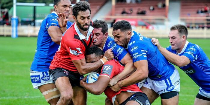 Newtown Jets backs James Tuitahi, Daniel Mortimer, Jesse Ramien and Matt Evans all combine to force North Sydney winger Sitiveni Moceidreke across the sideline in a tense moment at North Sydney Oval yesterday (Sunday, 14th May). Photo: Gary Sutherland Photography