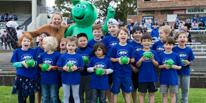 The Newtown Jets might have lost the game, but they made a lot of new friends among these children from St Brigid's Primary School, Marrickville who were the club's guests at Henson Park on Saturday. Syd the Pig from SCU – More Generous Banking joined the happy throng for this photo. Photo: Mario Facchini (MAF Photography)