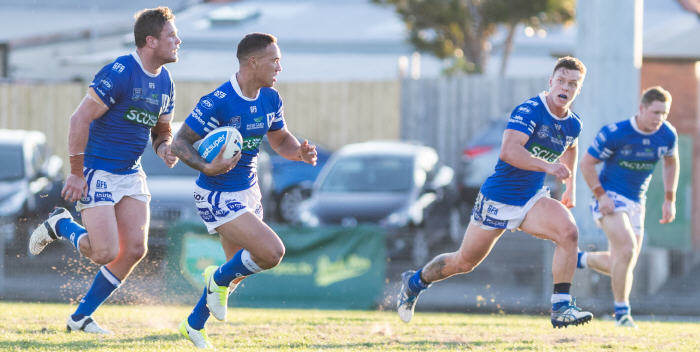 Newtown Jets hooker Manaia Cherrington makes a midfield break against Canterbury-Bankstown at Henson Park last Saturday, with (from left) Kurt Dillon, Leigh Higgins and Jack Williams all in support. Photo: Mario Facchini, MAF Photography