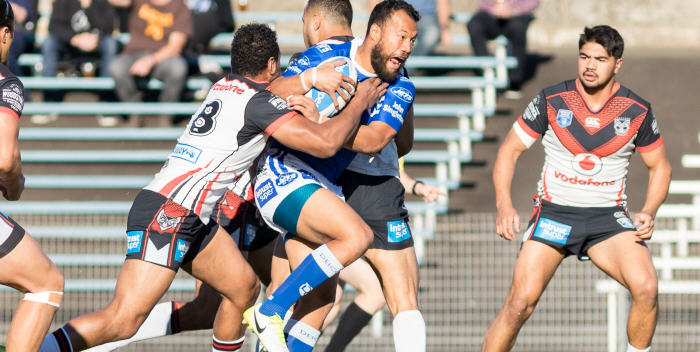 Newtown Jets five-eighth Joseph Paulo (with the ball) was in top form against the New Zealand Warriors at Henson Park last Saturday. Photo: Mario Facchini (MAF Photography)