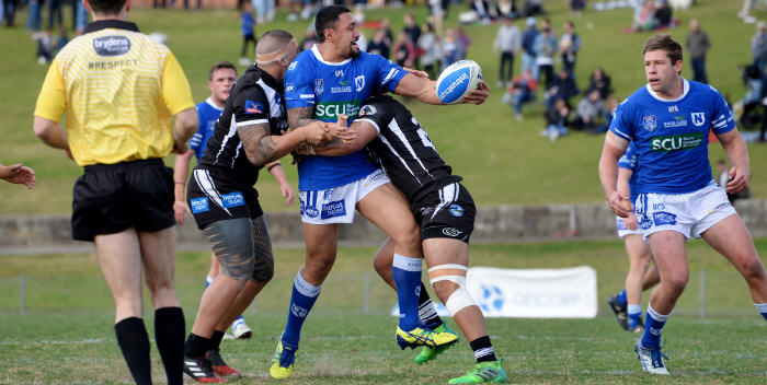 Newtown Jets backrower Kenny Niko looks to get the ball away to his team-mate Jeremy Latimore in last Saturday's match against Wentworthville at Henson Park. Photo: Michael Magee Photography.