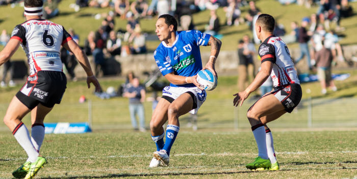 Newtown Jets halfback Kurt Kara swings out a pass on the grand occasion of his 150th game for rugby league's oldest club. Photo: Mario Facchini (MAF Photography)
