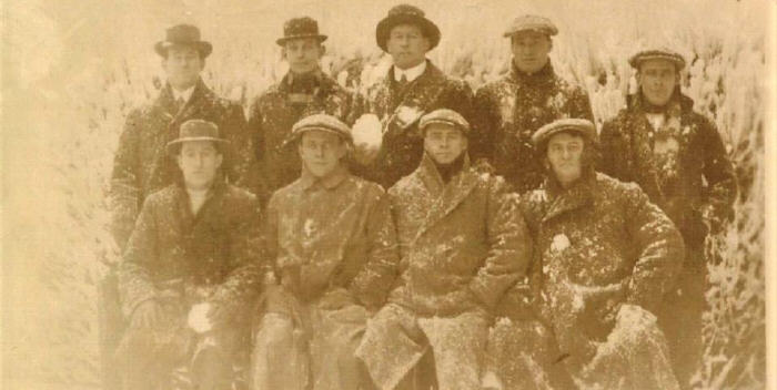 """This wonderful image from the 1911-12 Kangaroo tour shows the seven Newtown players that went on the trip as well as the two other members of the club that accompanied the team as official visitors.  They are - Back Row: Billy Noble, Doug Nelson (visitor), Paddy McCue, Joe Murray, Bill Farnsworth;  Front Row: Webby Neill, Viv Farnsworth, Charles """"Boxer"""" Russell, Tom Woolford (visitor)  The photo appears to have been taken in the midst of a snowball fight, given the dusting on their coats and the fact that McCue and Neill are both still holding snowballs, ready to resume action!  This atmospheric photo was supplied by the National Rugby League Museum, Driver Avenue, Moore Park."""