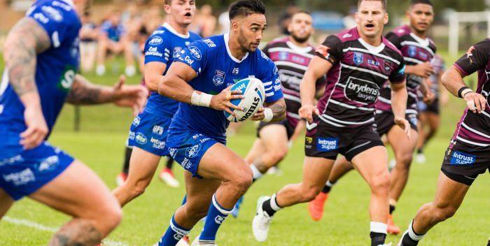 Newtown Jets second-rower Briton Nikora takes the ball forward against the Blacktown Workers defence yesterday. Nikora was forced to leave the field with a head knock late in the second half. Photo: Mario Facchini (MAF Photography)