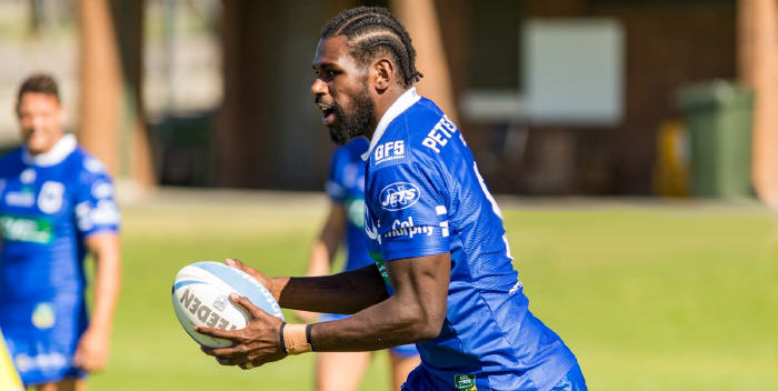Never underestimate the power of a good hairdo! Newtown winger Edrick Lee (sporting a cornrow hairstyle for the new rugby league season) in action for the Jets last Saturday against Wyong. Photo: Mario Facchini (MAF Photography)