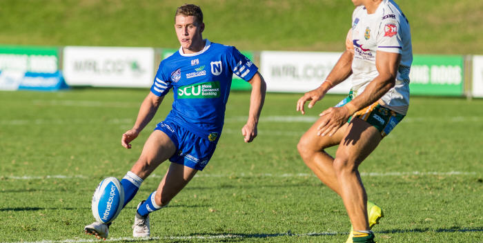 Newtown's five-eighth Jack Williams puts in a kick against the Wyong Roos on Saturday. Photo: Mario Facchini (MAF Photography)