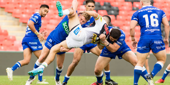 Newtown's five-eighth Jack Williams (left) and front-rower Braden Uele (right) combine to deal with this Penrith opponent on Saturday. Newtown Jets players in the background are (from left to right) second-rower Briton Nikora, fullback Will Kennedy and second-rower (number 16) Billy Magoulias. Photo: Mario Facchini (MAF Photography)
