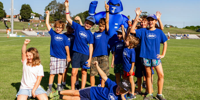 This group of children from Wilkins Public School enjoyed their visit to Henson Park on Saturday afternoon, as well as being entertained by Newtown's club mascot Jetman. Photo: Mario Facchini (MAF Photography)