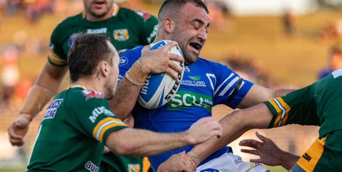 Newtown Jets backrower Anthony Moraitis is swarmed upon by Wyong defenders at Henson Park last Saturday. Photo: Mario Facchini (MAF photography)