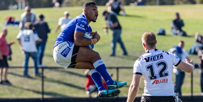 Newtown Jets winger Sione Katoa catches a Western Suburbs kick at Lidcombe Oval on Saturday. Photo: Mario Facchini (MAF Photography)