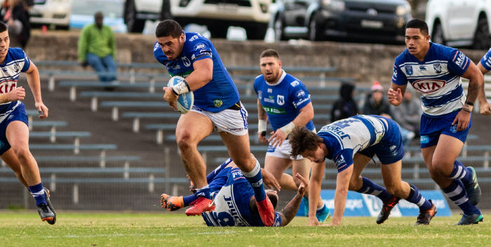 Newtown Jets front-rower Braden Uele rips through the Canterbury-Bankstown defence at Henson Park on Saturday, 2nd June. Photo: Mario Facchini (MAFphotography)