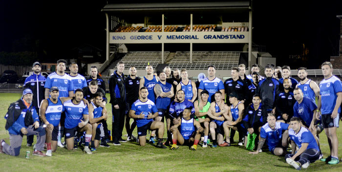 The Newtown Jets grand final training group had the historic King George V Memorial Grandstand in the background for this atmospheric photo shot on Thursday night. Photo: Michael Magee Photography.