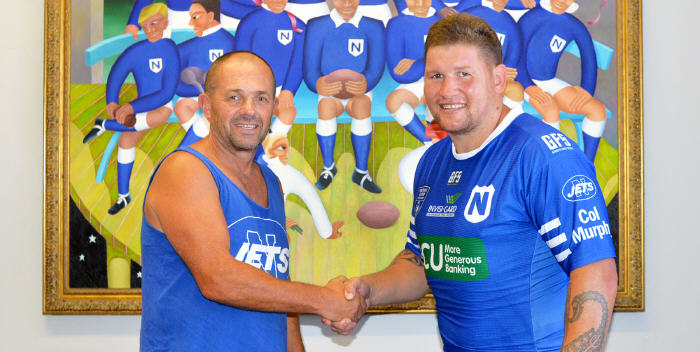 A done deal … Newtown Jets head coach Greg Matterson and new Jets signing Greg Eastwood shake hands after Eastwood had signed to play with the Newtown Jets in 2019. Photo: Mike Magee Photography.