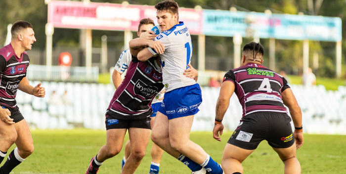 Newtown Jets hard-working backrower Royce Tout takes on the Blacktown Workers Sea Eagles defensive line in last Saturday's trial match at Shark Park. Photo: Mario Facchini, mafphotography