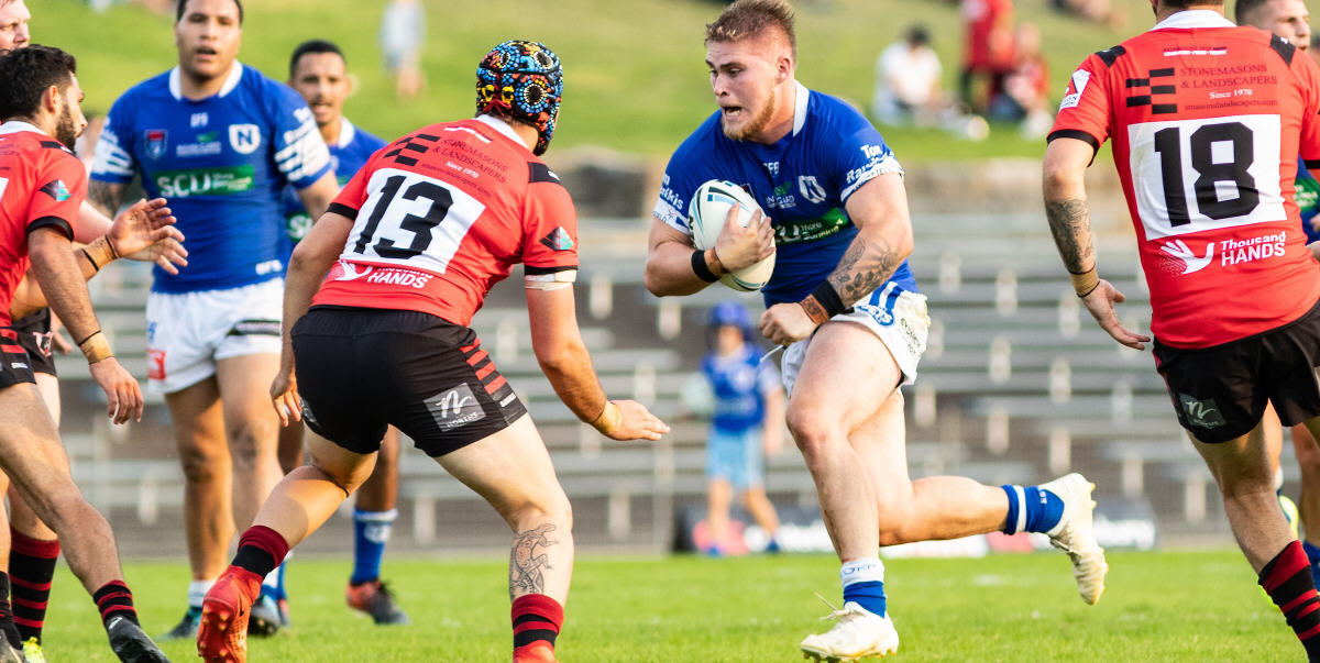 Newtown Jets forward Daniel Vasquez takes the ball up with customary vigour into the North Sydney defensive line at Henson Park last Saturday. Photo: Mario Facchini, mafphotography