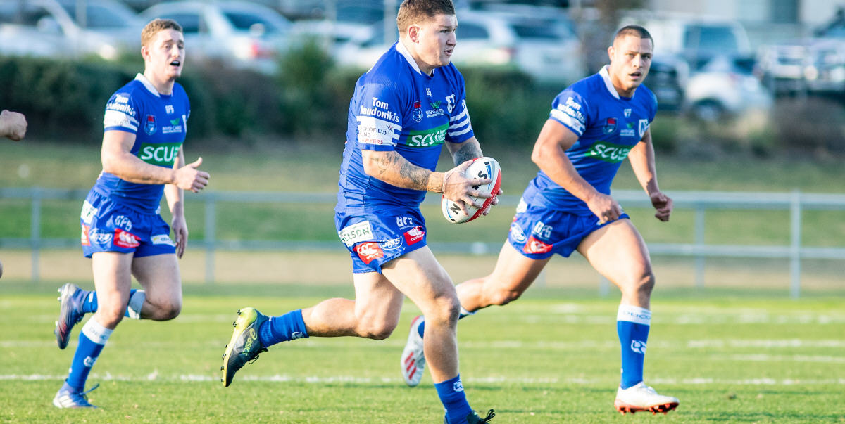 Greg Eastwood is pictured moving forward with the ball against Mounties, with Jets team-mates Jack A. Williams (left) and Scott Sorensen in support. Photo: Mario Facchini, mafphotography