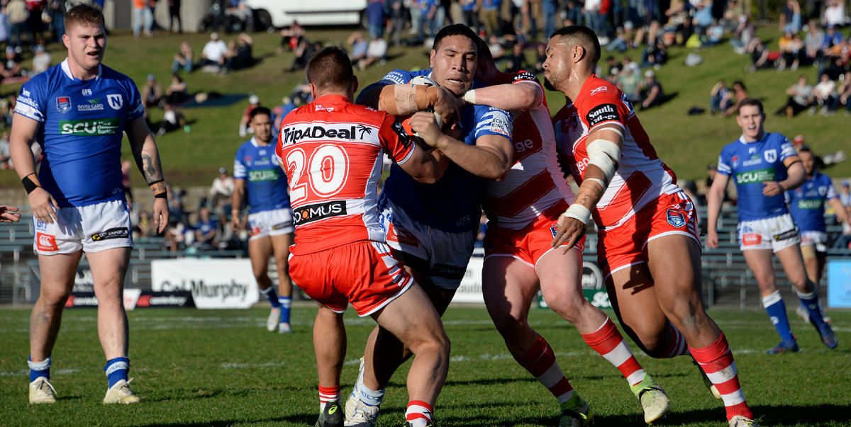 Newtown Jets front-rower Wes Lolo plunges into the middle of the St George-Illawarra defence at Henson Park last Saturday. The other Jets players visible in the photo are (from left) Daniel Vasquez, Will Kennedy, Jack A. Williams and Latrell Schaumkel. Photo: Mario Facchini, mafphotography