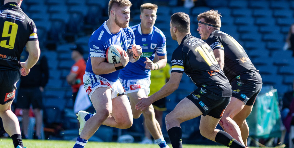 Newtown Jets forward Daniel Vasquez is about to crash into two Mounties defenders in last Saturday's elimination final at Campbelltown Stadium. Jets back-rower Teig Wilton is in the background. Photo: Mario Facchini, mafphotography