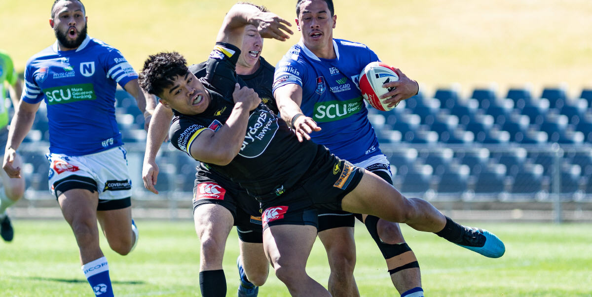 "Newtown Jets centre Jackson Ferris dishes out a definitive ""don't argue"" to an unfortunate Mounties opponent in Saturday's Canterbury Cup elimination final played at Campbelltown Stadium. Photo: Mario Facchini, mafphotography"