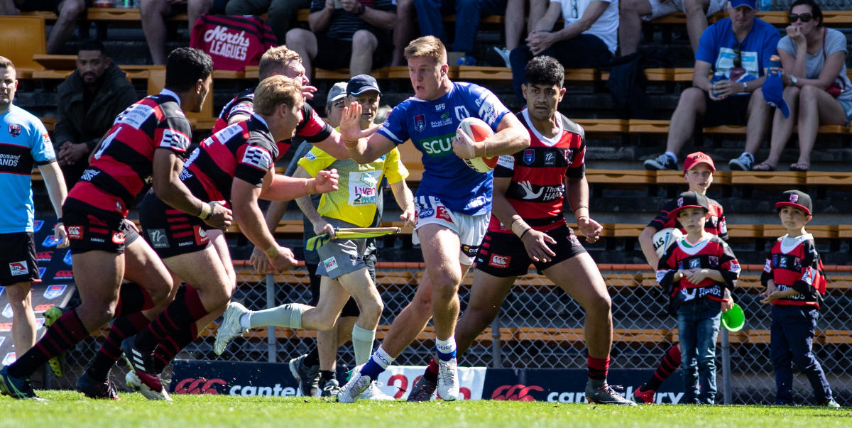 Newtown Jets backrower Teig Wilton attempts to ward off a posse of North Sydney Bears defenders at Leichhardt Oval last Sunday. Photo: Mario Facchini, mafphotography