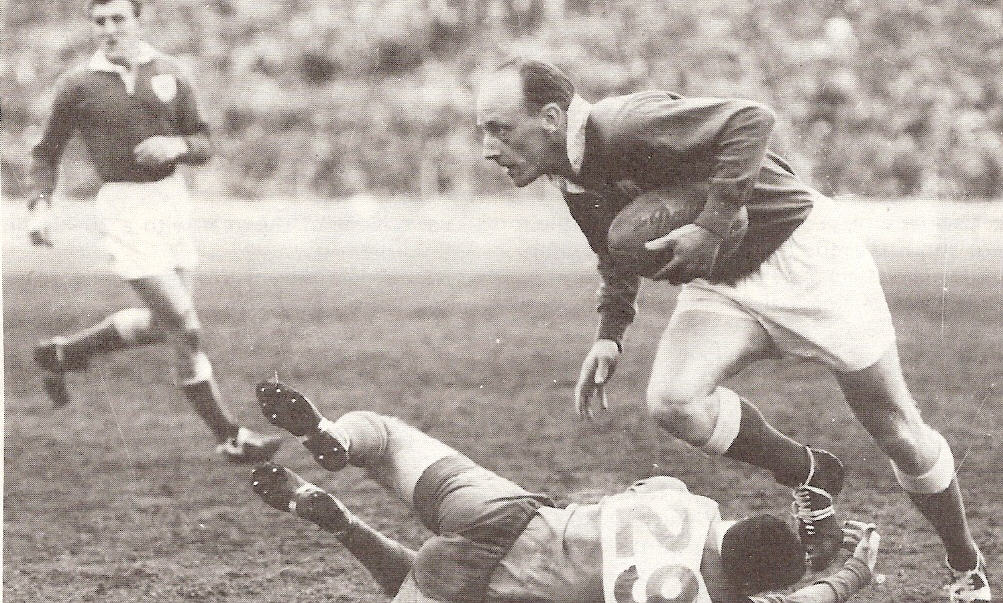 Newtown winger Ray Preston (with the ball) breaks clear in a match against South Sydney at the SCG in 1955. Newtown's captain-coach Dick Poole is in the background. Photo: Supplied by Terry Williams.