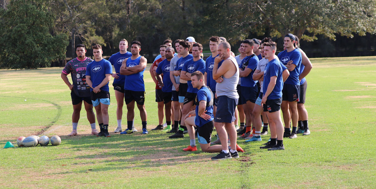 Newtown Jets head coach Greg Matterson pictured with members of the Jets pre-season training squad at Mahoney Reserve in South Marrickville on Tuesday, 17th December. Photo: Wayne Leong.