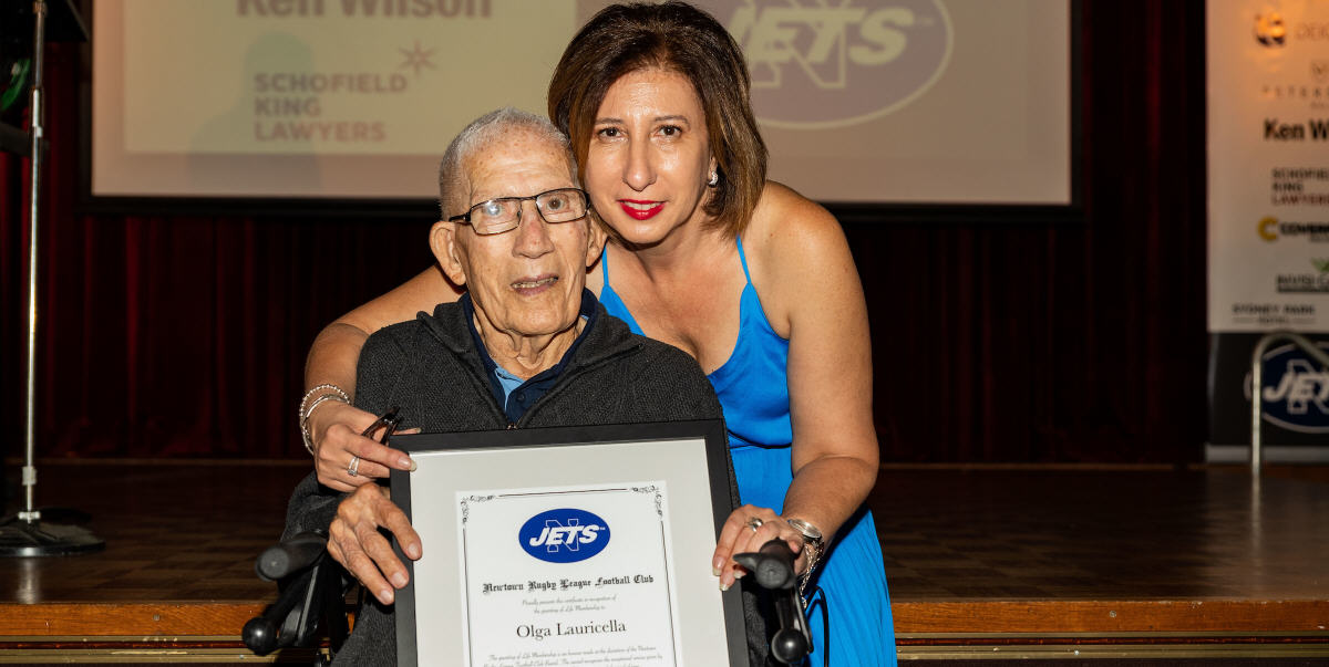 Photo caption: Olga Lauricella displays her framed Life Membership certificate (with her father Joseph ) at last Tuesday evenings Newtown Jets 2020 season launch. Photo: Mario Facchini (mafphotography).