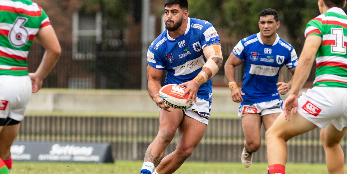 Newtown Jets front-rower Royce Hunt (formerly with Mounties and the Canberra Raiders) looks to pass to a team-mate in the match against South Sydney. Jets fullback Tyla Tamou is in the background. Photo: Mario Facchini, mafphotography