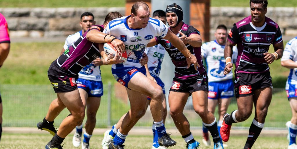 Newtown Jets front-rower Thomas Hazelton (a Goulburn Workers and Cronulla Sharks Jersey Flegg product) breaks through the Blacktown Workers Sea Eagles defence at Henson Park on Sunday. Photo: Mario Facchini, mafphotography