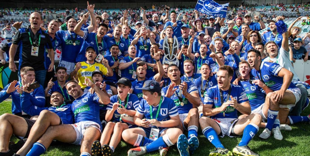 May the Spirit of 2019 forever inspire us! The Newtown Jets players, team staff and supporters were in full celebratory mode after fulltime at the NRL State Championship Final at ANZ Stadium on Sunday, 6th October 2019. Photo: Mario Facchini, mafphotography