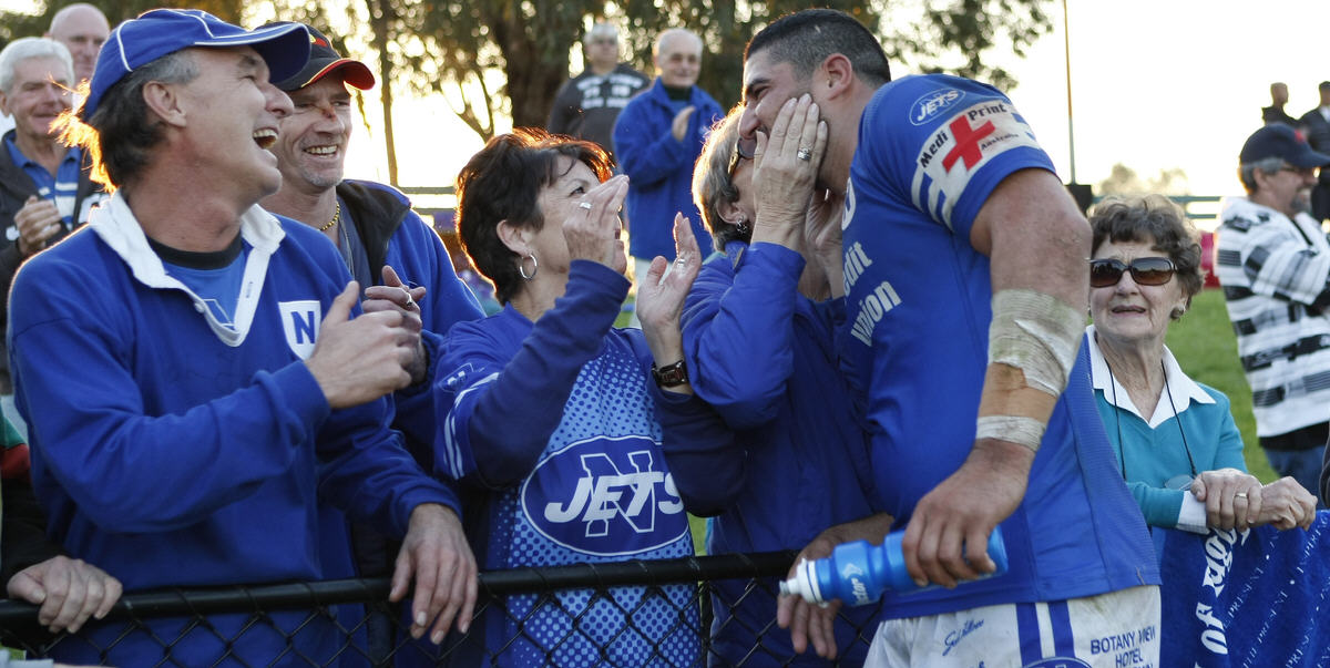 Newtown Jets team captain Khalid Deeb was always popular with Jets supporters because of his wholehearted displays, fearless leadership and accessibility to fans. On this occasion these Jets supporters were ecstatic following the rousing display by the Newtown Jets against a red-hot Canterbury Bulldogs team. Photo: Mike Biboudis.