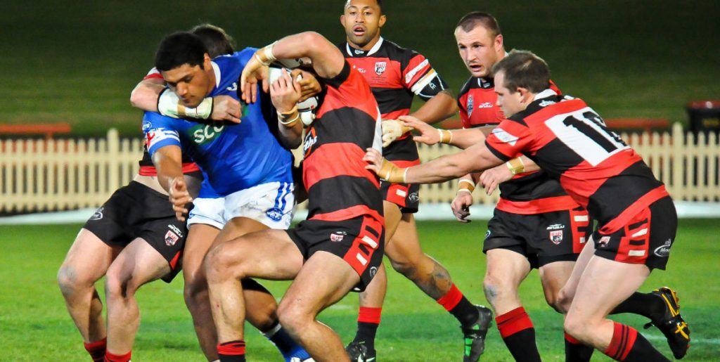 Newtown Jets front-rower Saulala Houma attempts to break through this sleuth of North Sydney Bears defenders in the exciting NSW Cup match played at North Sydney Oval on the night of Friday, 10th August 2012. Photo: Gary Sutherland Photography