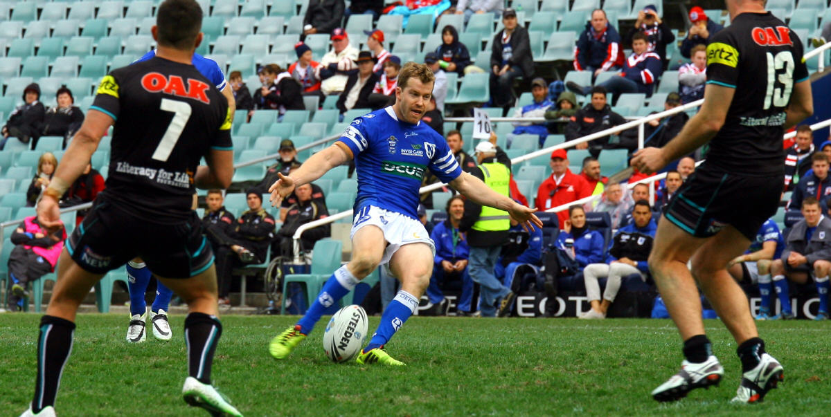 Newtown Jets halfback Scott Dureau kicks a vital field goal in Newtown's pulsating encounter against competition leaders Penrith at Allianz Stadium back on 19th July 2014. Dureau was one of the best field-goal exponents in rugby league and performed with aplomb for the Newcastle Knights, Sydney Roosters, Newtown Jets and Catalans Dragons. Photo: Mario Facchini, mafphotography
