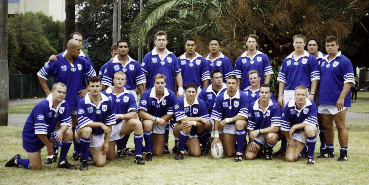 This week's nostalgia team from the dim and distant past is the Newtown Jets line-up that played in the club's first competition game in the NSWRL First Division. This match was played against St George-Illawarra at Redfern Oval on Saturday, 4th March 2000. The team was as follows:- Back row, standing left to right: Tere Glassie, Adam Bennett (obscured), Jason Bell (obscured), Phil Howlett, Peter Howie, Odell Manuel, Clinton Toopi, Paul Carige, David Myers, Wairangi Koopu, Terry Hermansson. In front, left to right: Brad Westaway, David Howlett, Clinton McAulliffe, Luke Wardle, Luke Goodwin (Capt), Tony Catton, Jared Mills, Joey Bishop, Daniel Cross, Luke Ellis. The team was coached by Colin Murphy. Photo supplied by the Newtown RLFC.