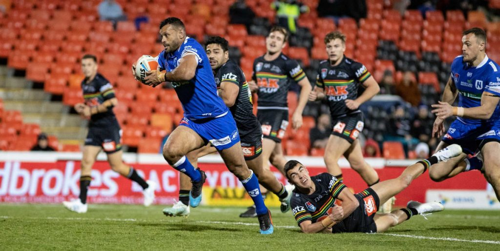Jayson Bukuya breaks clear to score an outstanding try for Newtown against the Penrith Panthers on the night of 9th August 2019. This win on a frosty night at Panthers Stadium was a game that gave the Newtown Jets decided momentum as they headed towards a final series for the ages. Photo: Mario Facchini, mafphotography
