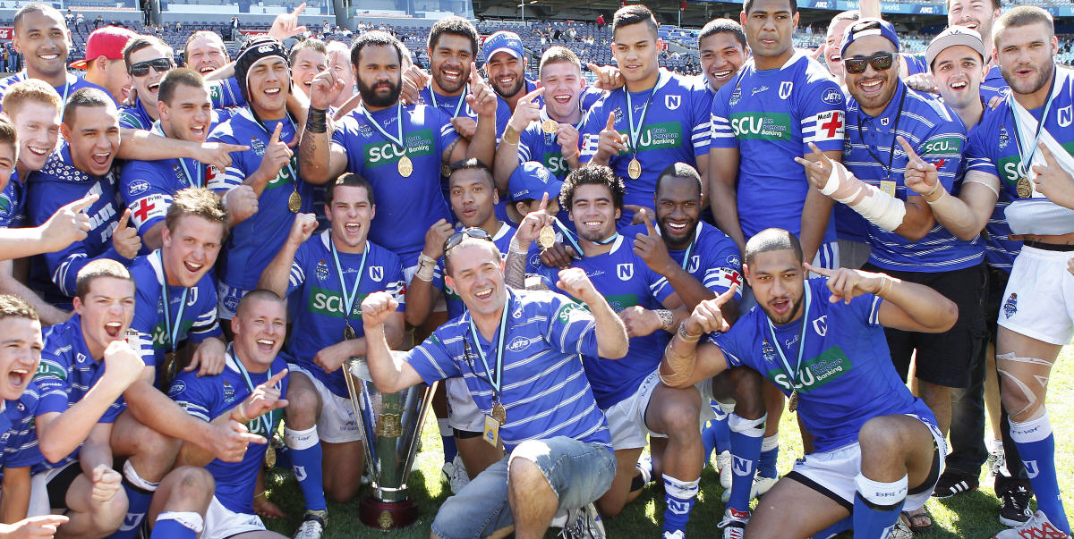 How sweet it is! The 2012 Newtown Jets celebrate their premiership victory. Image: Mike Biboudis