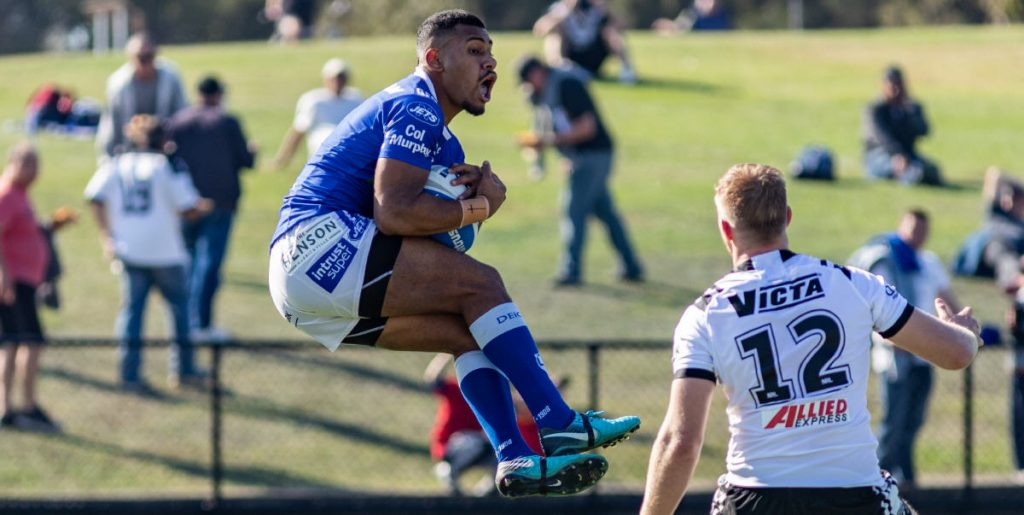 Newtown Jets winger Sione Katoa catches a Western Suburbs kick at Lidcombe Oval on Saturday. Photo: Mario Facchini, mafphotography