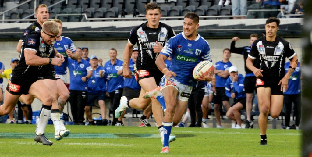 Newtown Jets man of the match fullback Will Kennedy gets into full stride on his way to scoring the match-winning try in last season's stirring Canterbury Cup NSW grand final victory. Photo: Michael Magee Photography.