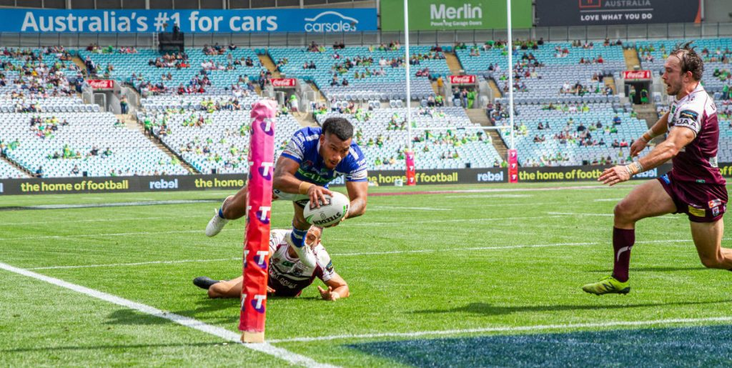 Newtown Jets winger Sione Katoa scores his second try just five minutes out from full-time at ANZ Stadium last Sunday. Photo: Mario Facchini, mafphotography