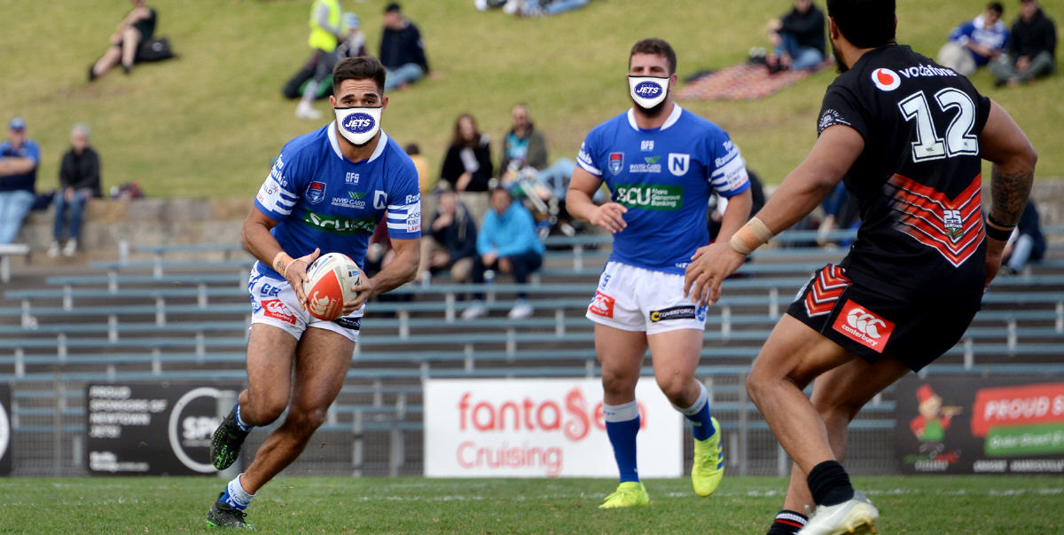 This time last year Will Kennedy (left) and Billy Magoulias were heavily involved in helping to bring home two prestigious rugby league trophies to the Newtown Jets silverware cabinet. Right now they are recommending that Jets fans everywhere buy Newtown Jets face masks for top-value protection from the coronavirus. Photo: Michael Magee Photography.
