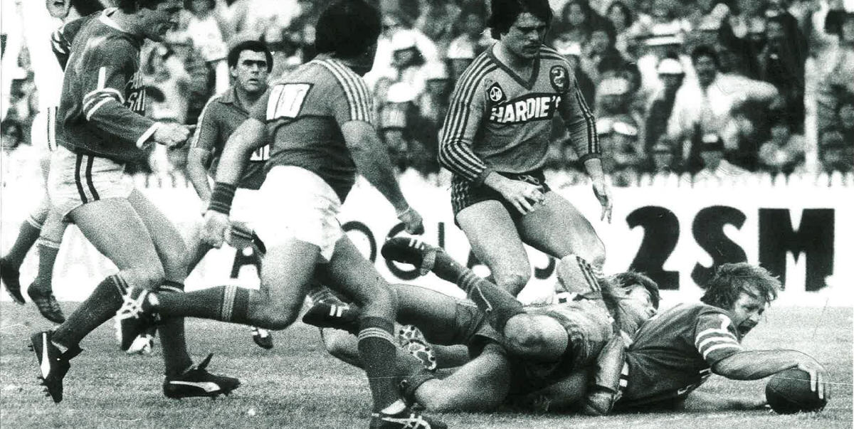 Tommy Raudonikis, pictured here scoring in the 1981 Grand Final, had the honour of captaining his state in the first-ever Origin game.